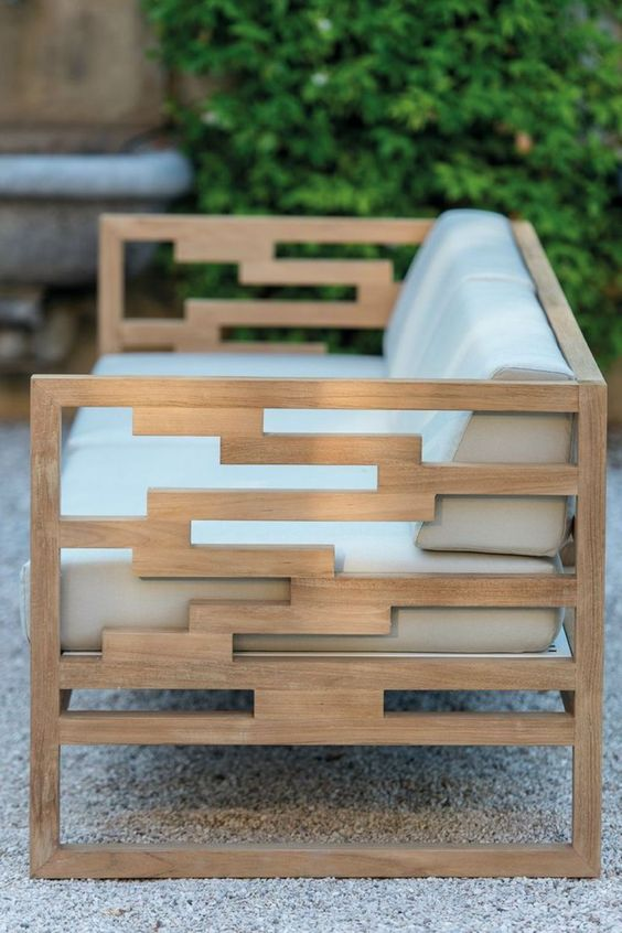 modern teak bench with off-white upholstery looks chic