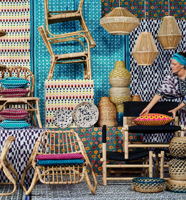 There are various furniture pieces, lampshades mixed with colorful textiles