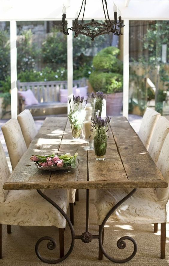 a rustic and shabby chic table with a rough edge and metal legs