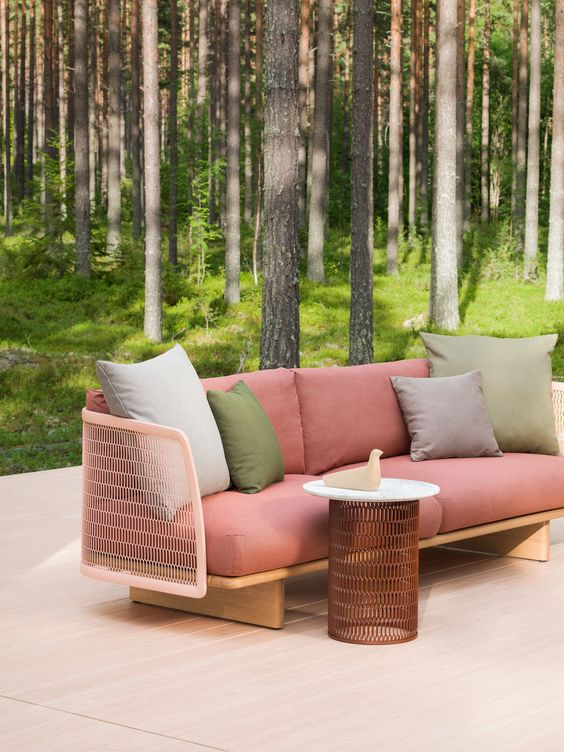 comfy wooden and metal mesh furniture in different shades by Patricia Urquiola