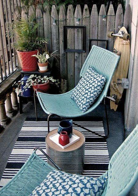 blue wicker chairs on a black frame stand out and remind of beaches