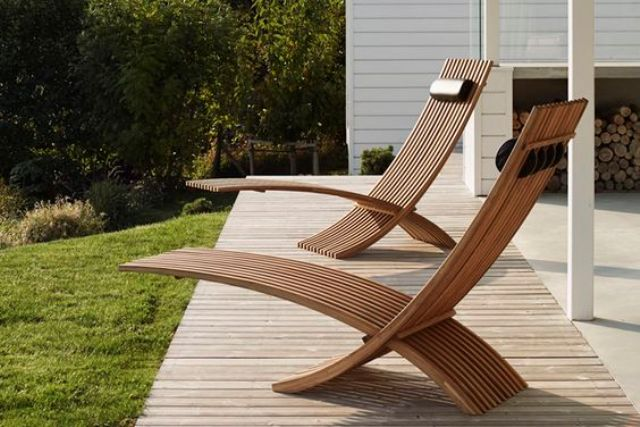 chic sculptural teak loungers for a modern outdoor space