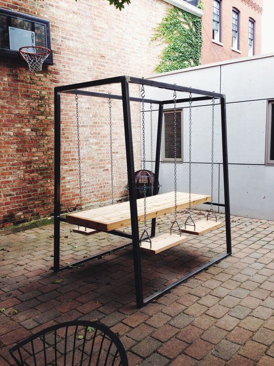 14 dining swingset with a suspended table and seats