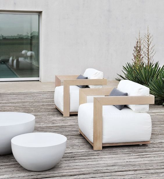 cool light-colored wooden chairs with armrests and white upholstery
