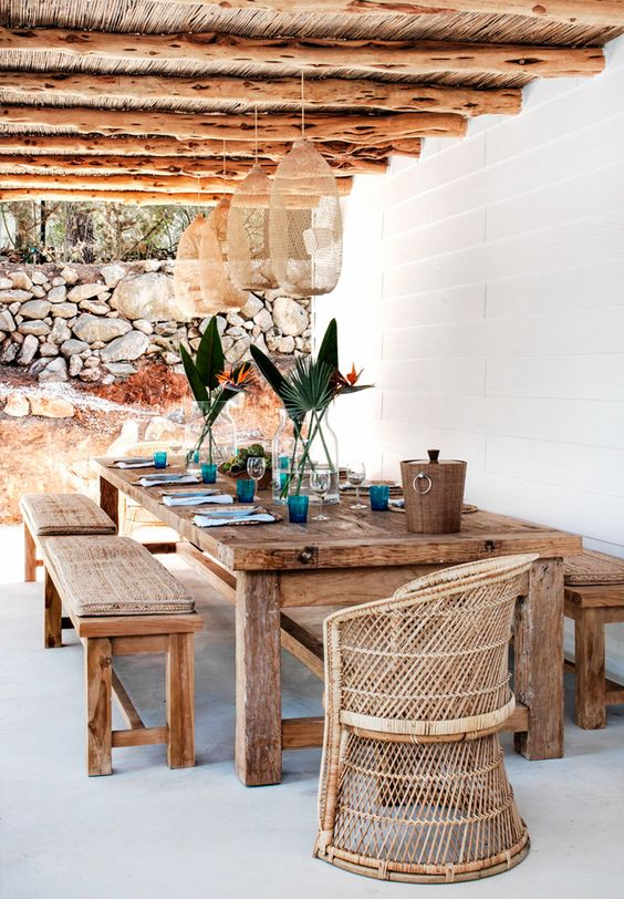 shabby rustic wooden table and benches for a Mediterranean terrace