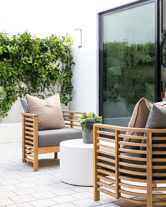 stylish wooden light-colored chairs with grey upholstery will fit any modern space
