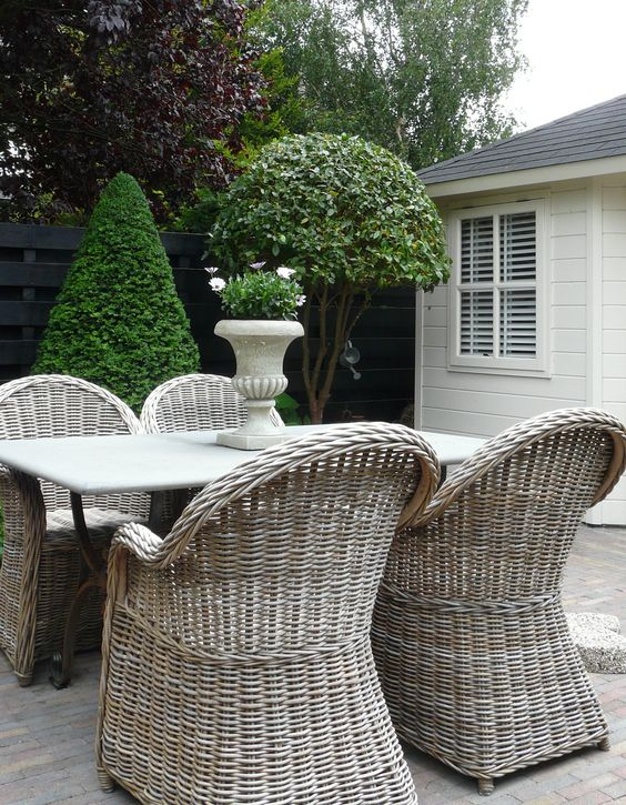 cute and simple wicker chairs with armrests fit any rustic space