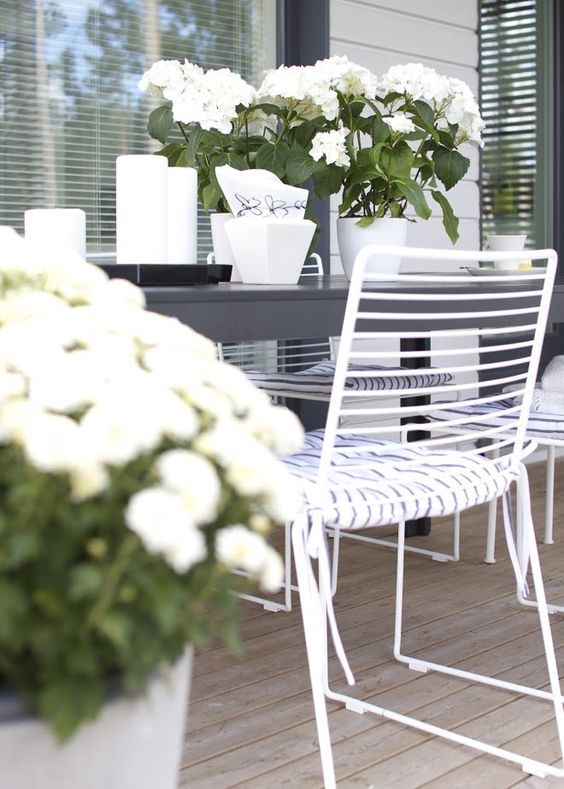 simple metal dining chairs in white with pillow seats