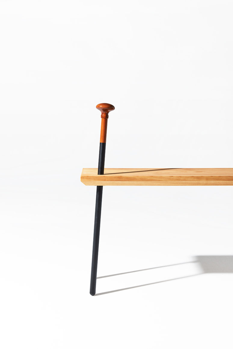 The cane both serves as a novelty leg for the bench, and as a means of support to elderly patrons